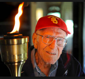 Louie Zamperini with the Olympic torch.