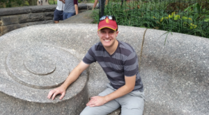 """My son Greg at one end of """"The Whisper Bench"""" in Central Park's Shakespeare Garden."""